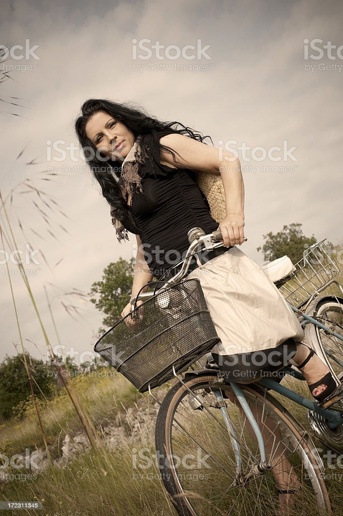 Pretty Woman with Bicycle royalty-free stock photo