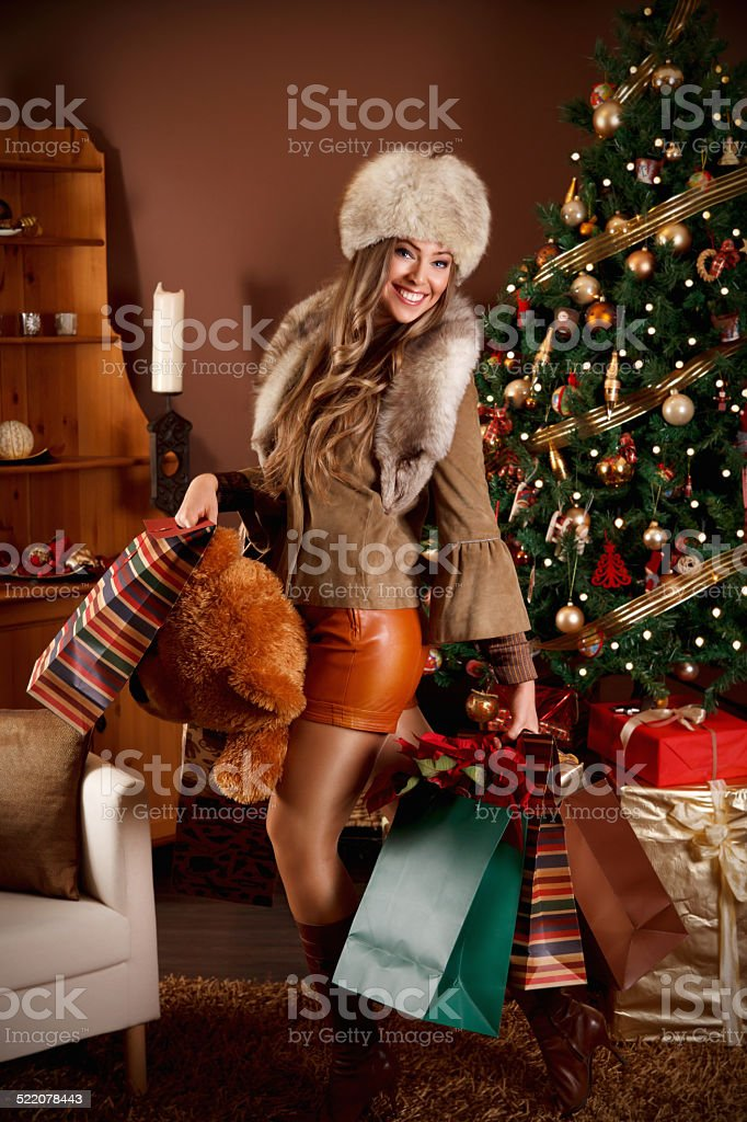Pretty woman with Christmas presents stock photo