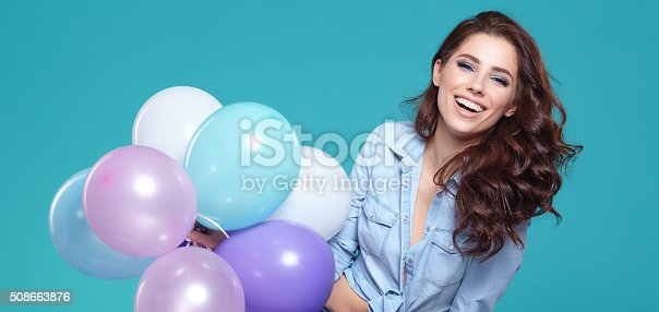 istock Pretty woman with colored balloons 508663876
