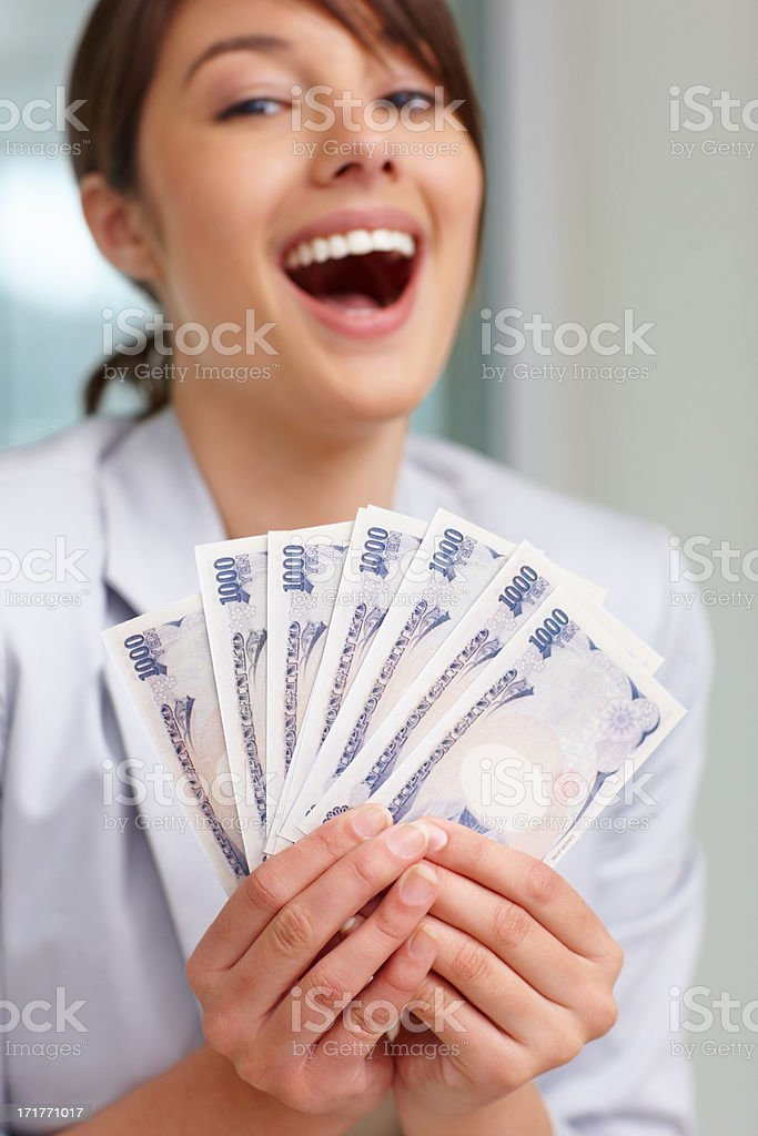Pretty woman with currency notes on white  royalty-free stock photo