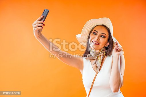 istock Pretty woman with dental braces doing selfie on smartphone camera 1208817280
