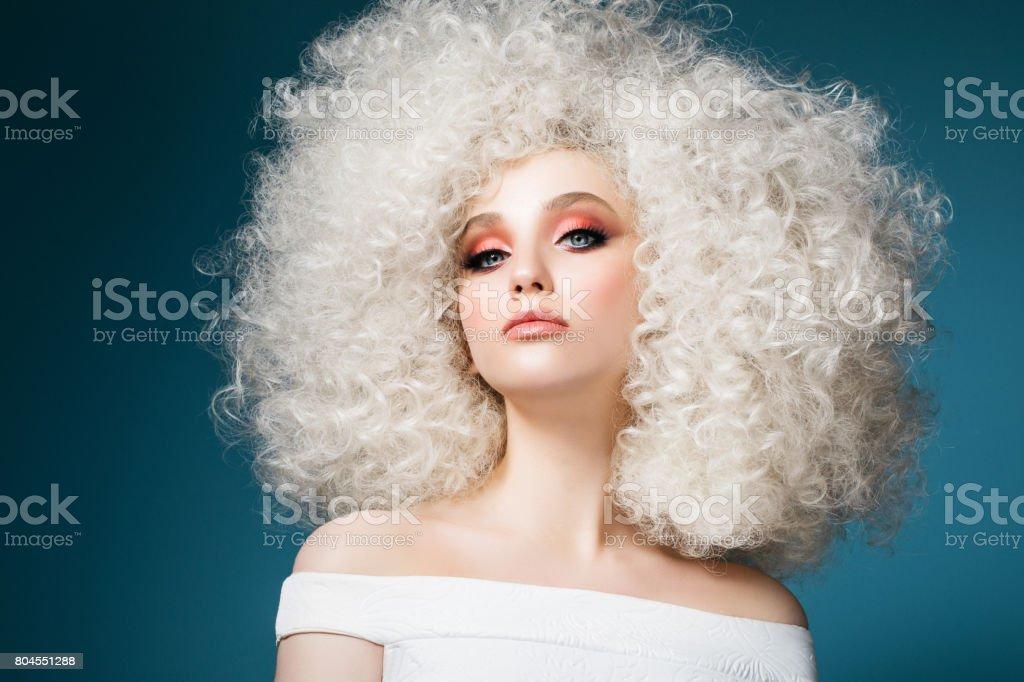 Pretty woman with extravagant hairstyle – zdjęcie