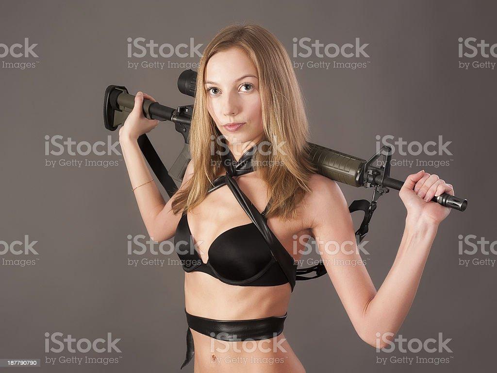 Pretty woman with gun royalty-free stock photo