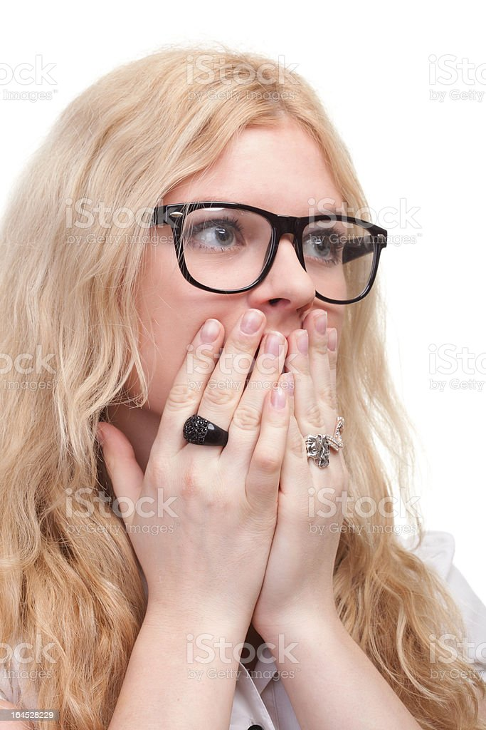 pretty woman with hands over mouth royalty-free stock photo