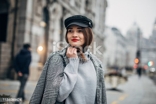 518885222istockphoto Pretty woman with hat 1134099424