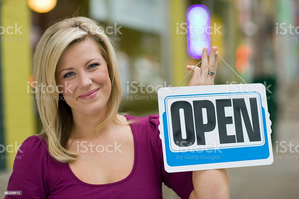 Pretty woman with open sign royalty-free stock photo