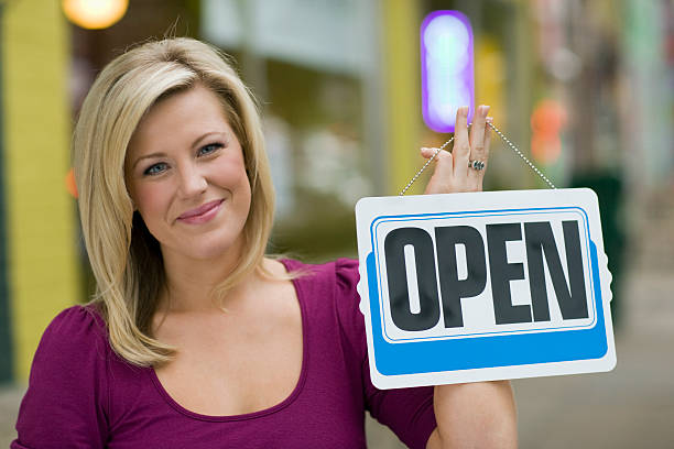 Pretty woman with open sign stock photo