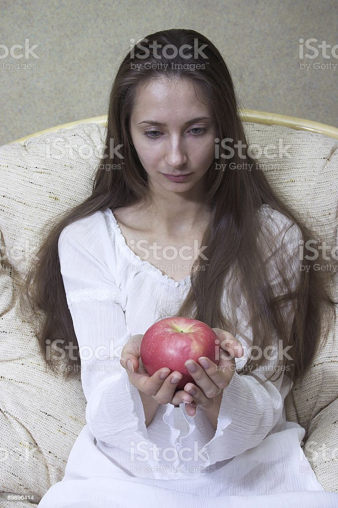 Pretty woman with red apple royalty-free stock photo