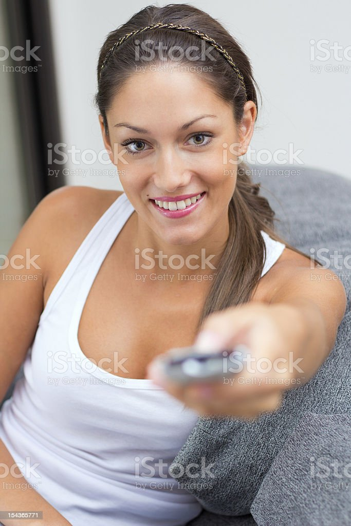 pretty woman with remote control at home royalty-free stock photo