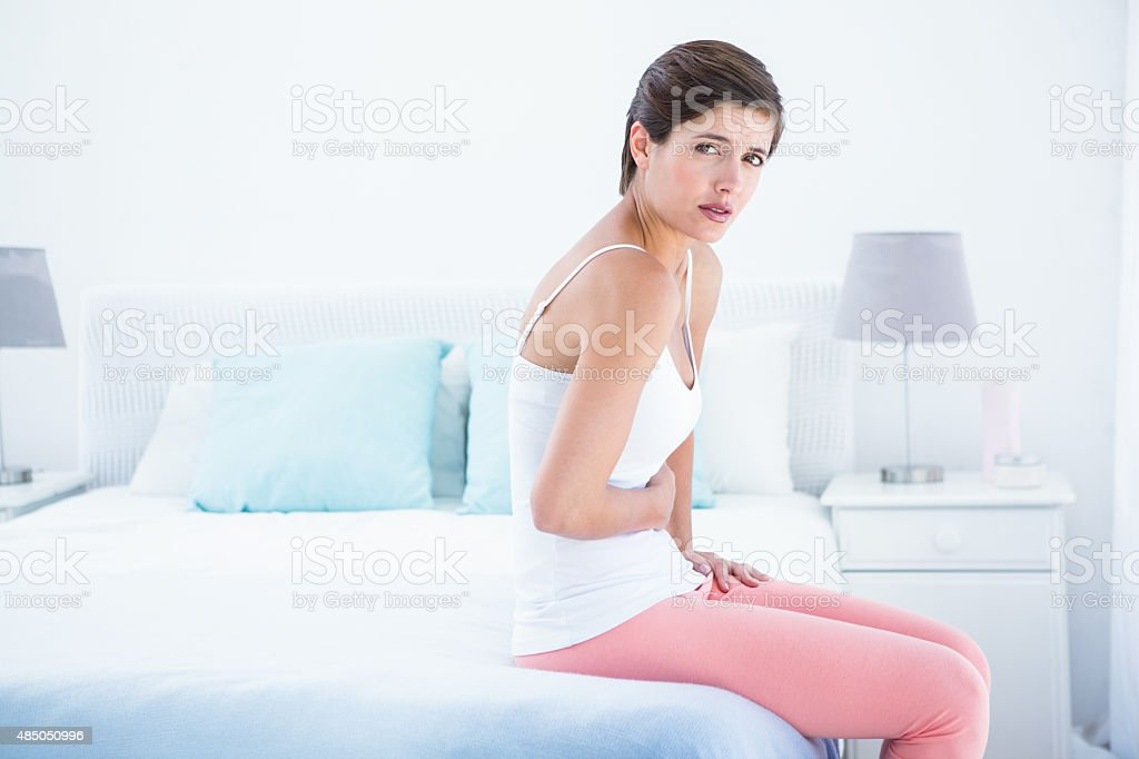 Pretty woman with stomach pain stock photo