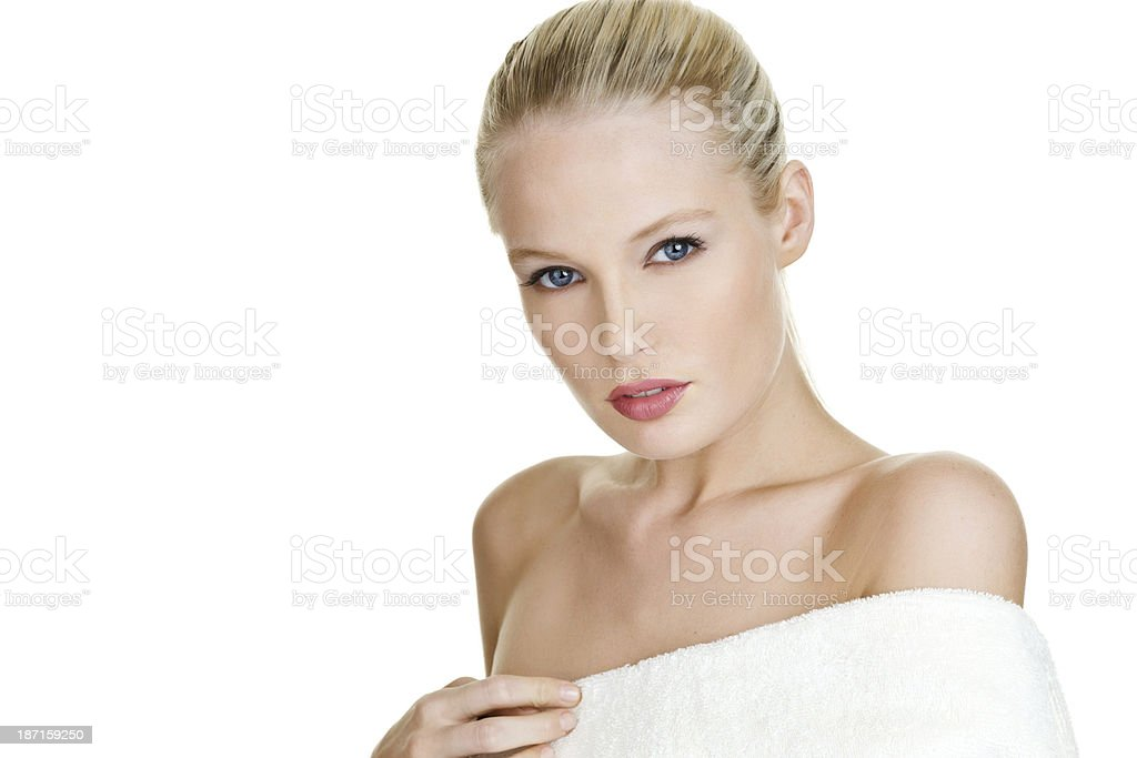 Pretty woman wrapped in a towel royalty-free stock photo