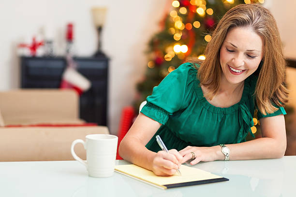 Royalty free woman writing letter pictures images and stock photos pretty woman writing letter at christmas stock photo publicscrutiny Gallery