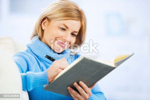 istock Pretty woman writing 182035969