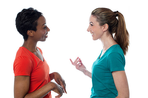 Pretty women having a discussion stock photo