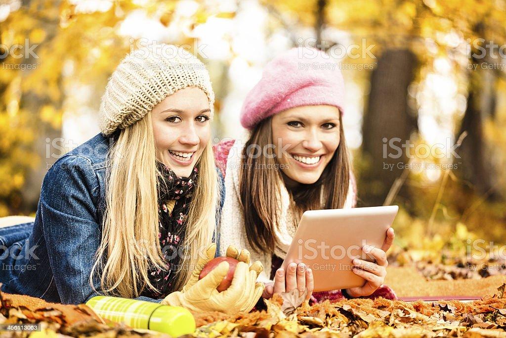Pretty women reading digital tablet royalty-free stock photo