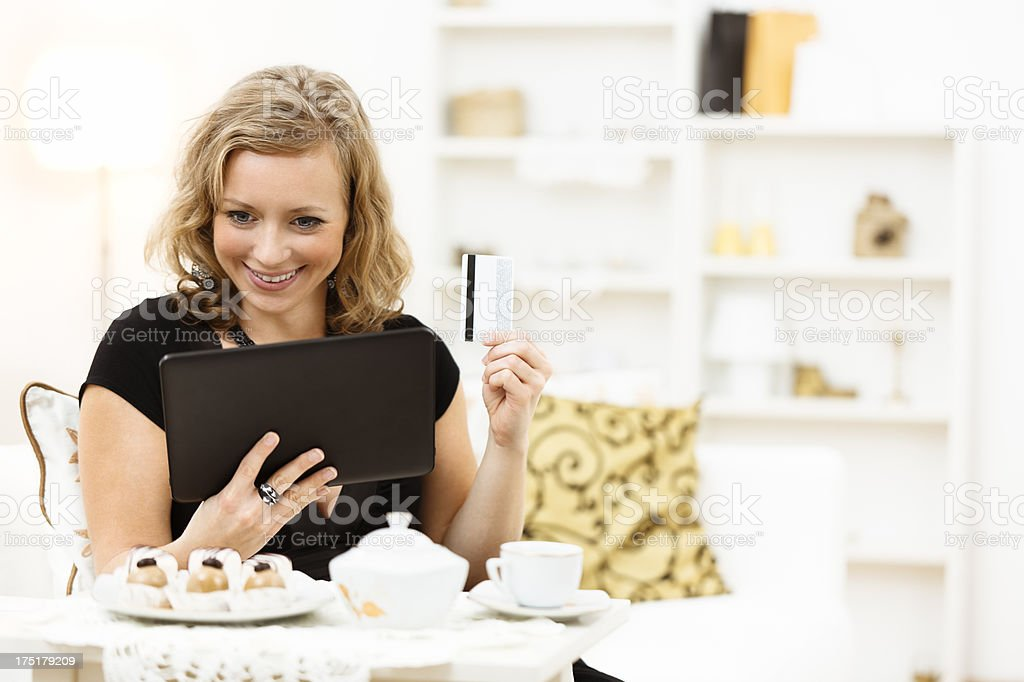 Pretty women shopping at home royalty-free stock photo