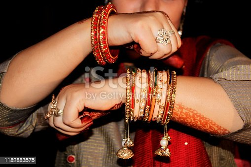 Pretty women showing bangle in front of the camera