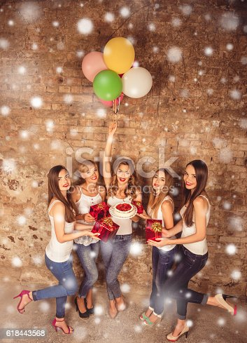 istock Pretty women with presents, balloons and cake, xmas concept 618443568