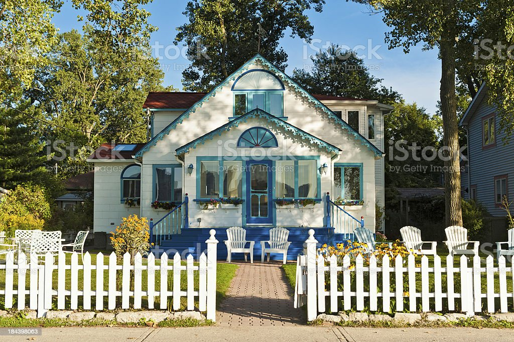 Pretty wooden cottage white picket fence Toronto Island Canada stock photo