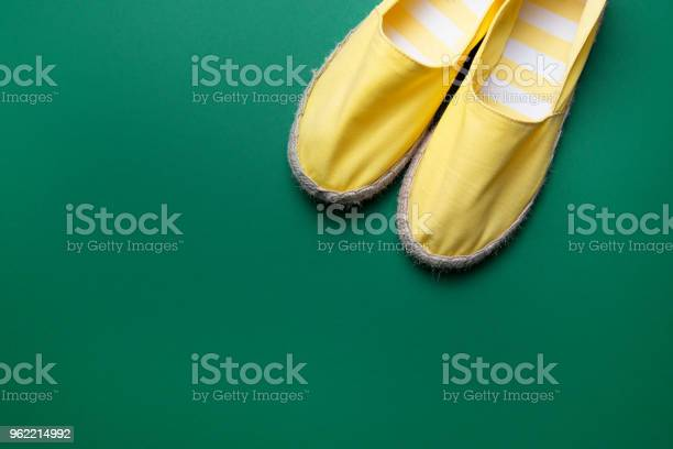 Pretty yellow summer shoes on the green background espadrilles picture id962214992?b=1&k=6&m=962214992&s=612x612&h=vakrrw8dq3ixssbazz82bpv7cpngaxovoermzh05g y=