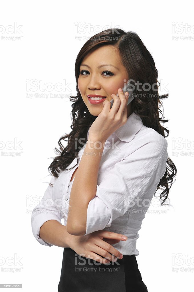 Pretty young asian businesswoman on the cellphone royalty-free stock photo