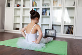 istock Pretty young ballerina practicing classic choreography during online class in ballet school, social distance during quarantine, self-isolation, online education concept 1216940722