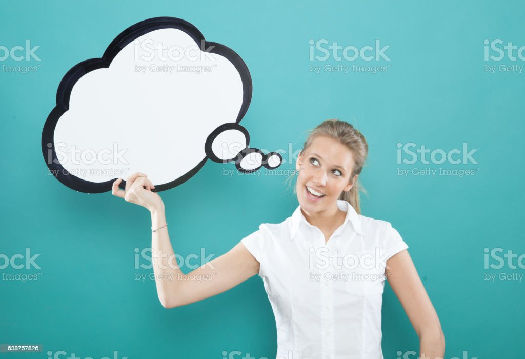 pretty young blond caucasian woman smiling with comic baloon stock photo
