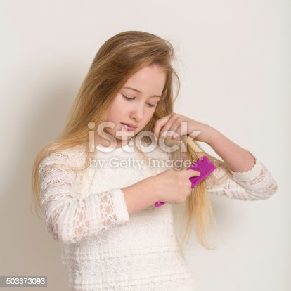 625205382 istock photo Pretty Young Blond Girl Brushing Her Hair 503373093