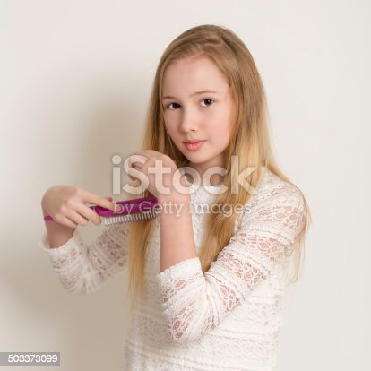 625205382 istock photo Pretty Young Blond Girl Brushing Her Hair 503373099