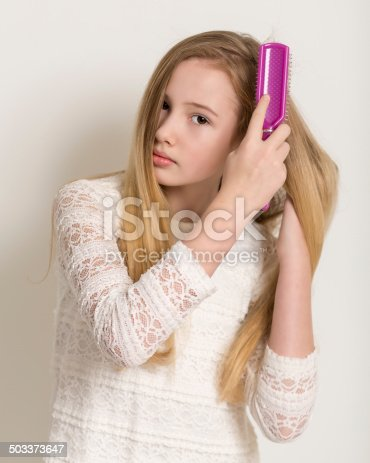 625205382 istock photo Pretty Young Blond Girl Brushing Her Hair 503373647