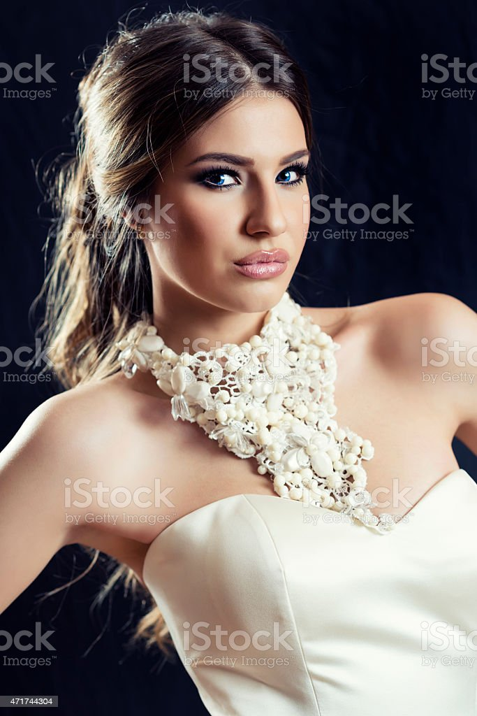 Pretty Young Bride with Beautiful Hairstyle and Make-up stock photo