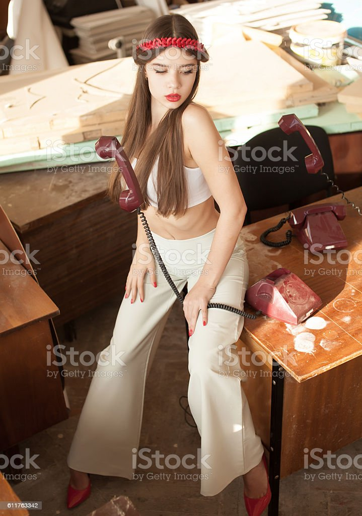 Pretty young brunette lady in a fashion pose stock photo