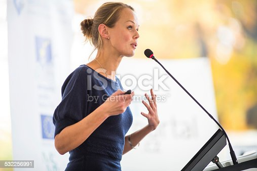 istock Pretty, young business woman giving a presentation 532256991