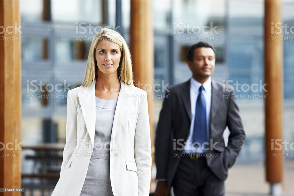 Pretty young business woman walking - Outdoors royalty-free stock photo