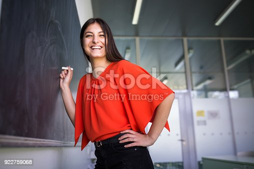 922759140 istock photo Pretty, young college student writing on the chalkboard/blackboard 922759068