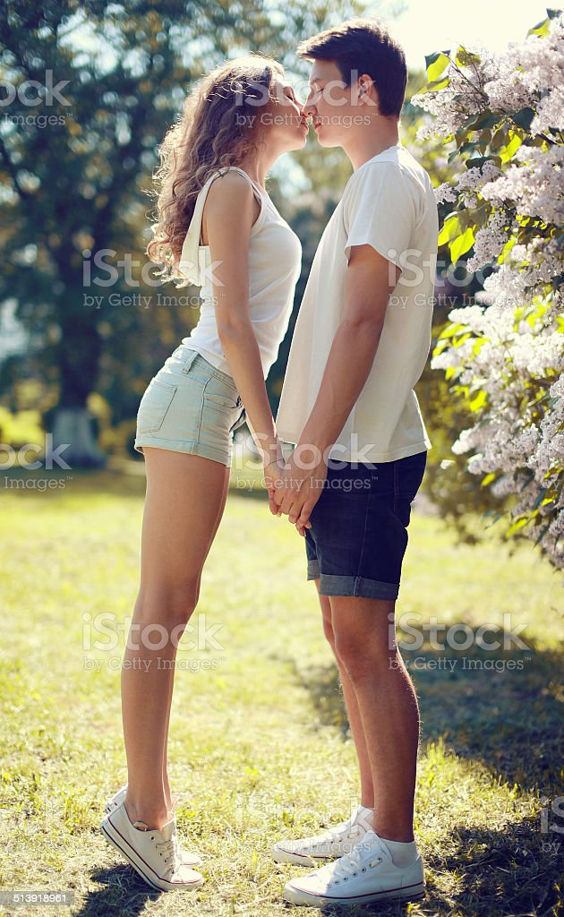 Pretty young couple in love, sensual kiss stock photo
