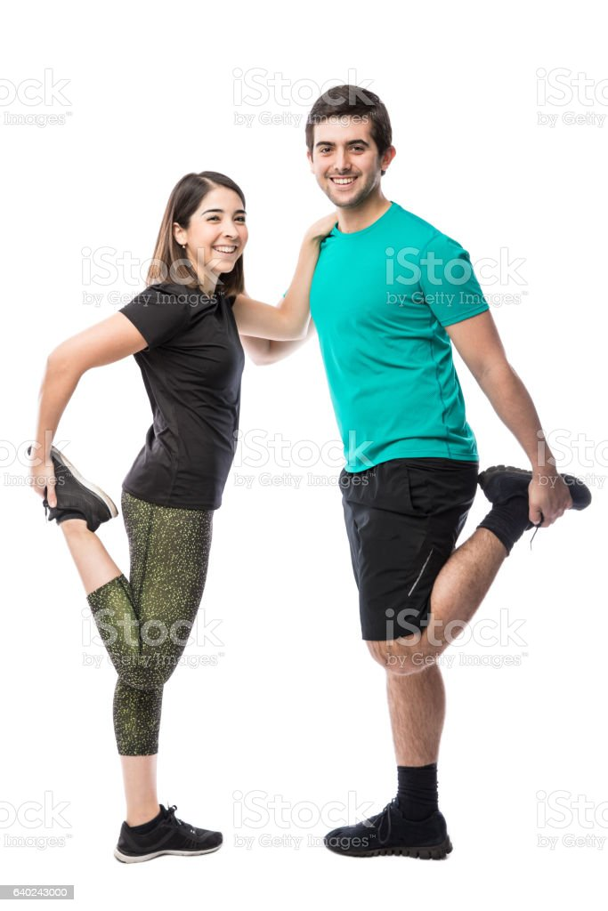 Pretty young couple stretching their legs stock photo