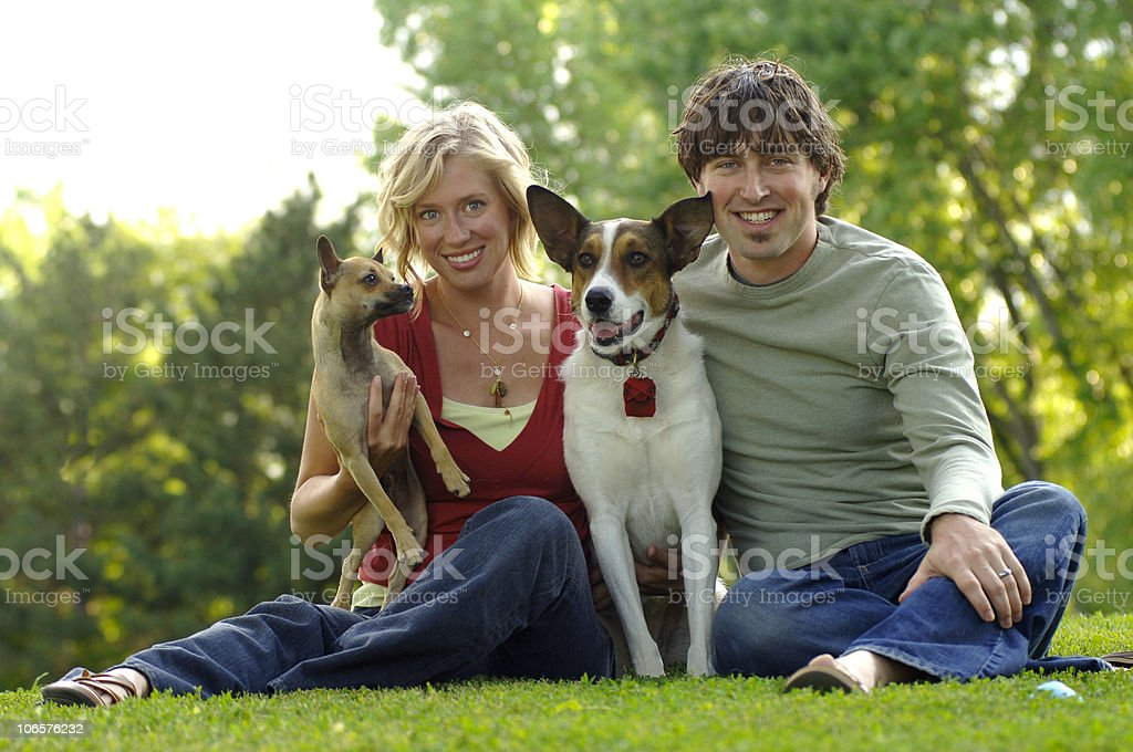 Pretty Young Family with Dogs royalty-free stock photo