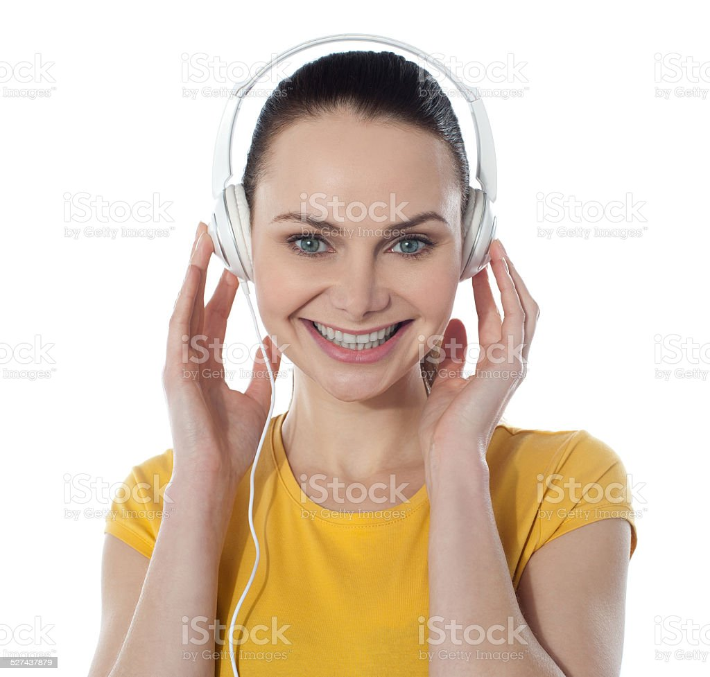 Pretty young female enjoying music royalty-free stock photo