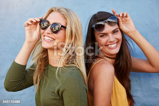 istock Pretty young female friends having fun 545110488