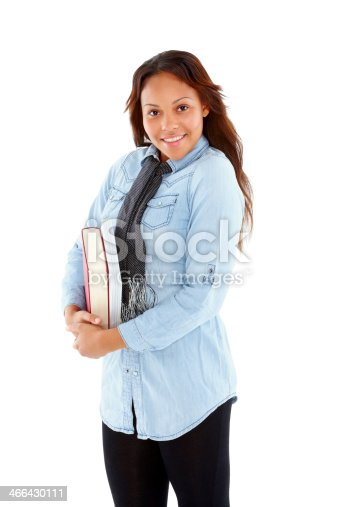 istock Pretty young female student holding books 466430111