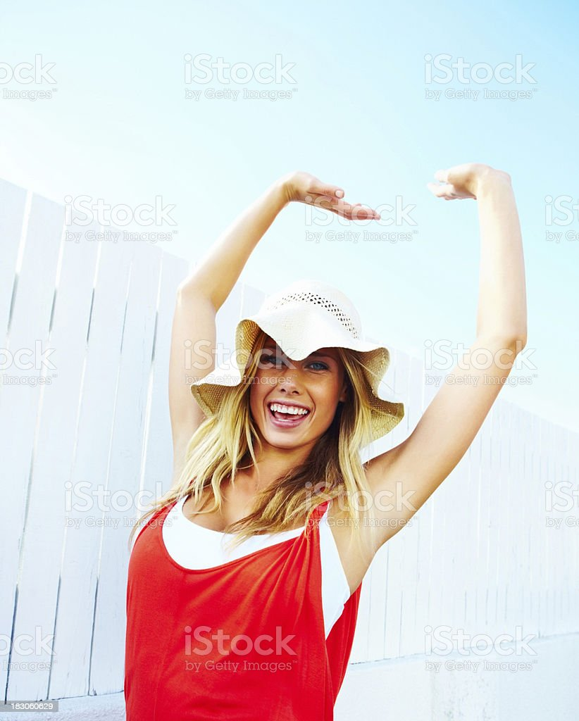 Pretty young female with hands raised in excitement royalty-free stock photo