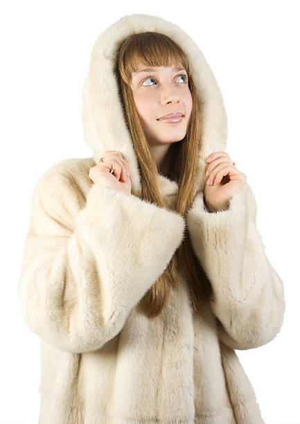 Pretty young girl in fur jacket stock photo