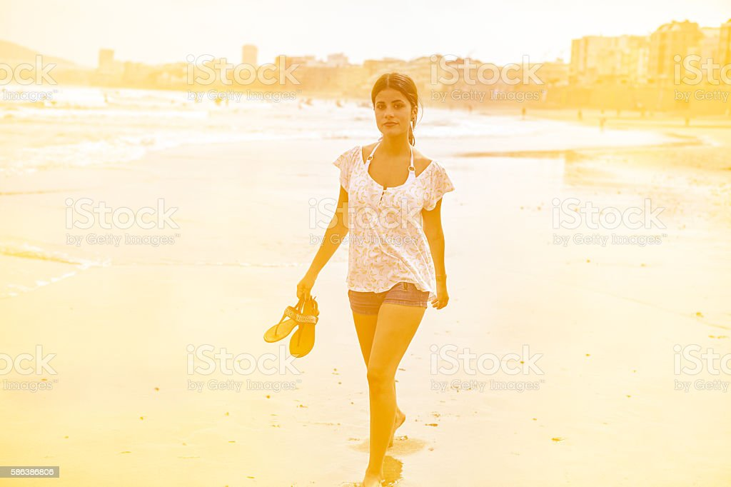 Pretty young girl in the breaking waves stock photo