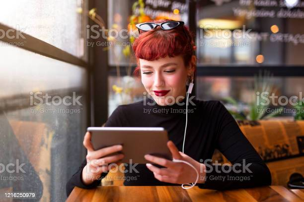 Pretty young girl is using tablet picture id1216250979?b=1&k=6&m=1216250979&s=612x612&h=eqktwnsi4v6xuiwdcb7mmxpsy4nfubtczppfpcoozza=