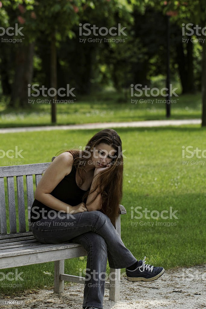 pretty young girl on a bench royalty-free stock photo