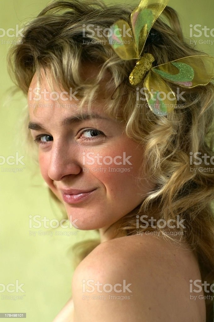Pretty young girl on the green bright background stock photo