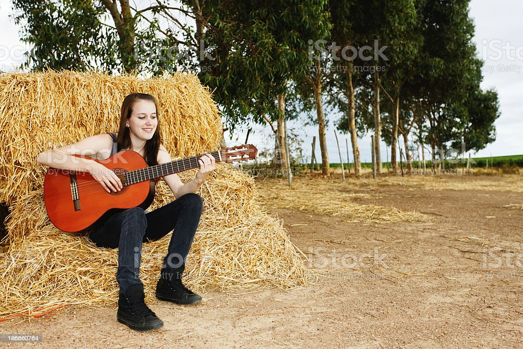 pretty young girl plays guitar on the farm stock photo more