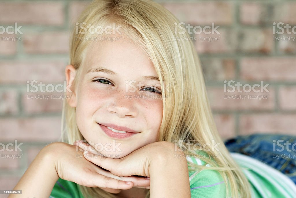 Pretty Young Girl Posing with Hands Under Chin royalty-free stock photo