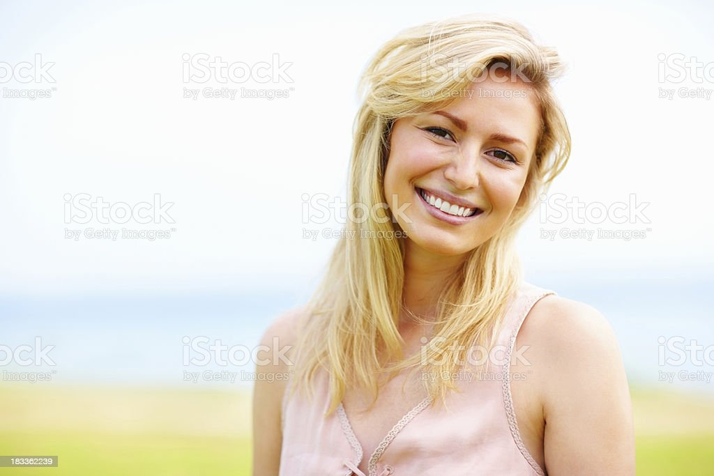Pretty, young girl smiling - outdoors royalty-free stock photo
